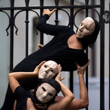 Enigmatic actors wearing masks. Royalty Free Stock Images