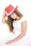 Enigmatic bride. Beatiful bride in red hat looking to camera isolated Royalty Free Stock Images