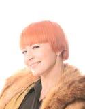 Enigmatic gaze. Beautiful redhead woman looking with enigmatic gaze Stock Photo