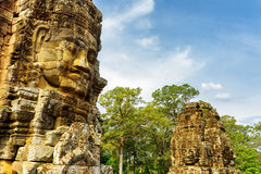 Enigmatic giant stone faces of ancient Bayon temple in Angkor Royalty Free Stock Photography