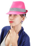 Enigmatic girl portrait w hat. Portrait of eccentric and enigmatic Asian girl in fashionable outfit, peering mysteriously and mesmerizing under the edge of a Royalty Free Stock Image