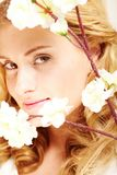 Enigmatic lady. Portrait of an enigmatic lady with white flowers Royalty Free Stock Photo