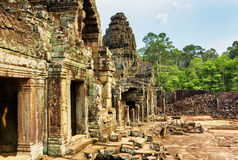Enigmatic ruins of ancient Bayon temple, Angkor Thom, Cambodia. Enigmatic ruins of ancient Bayon temple in Angkor Thom, Siem Reap, Cambodia. Mysterious Angkor Royalty Free Stock Images