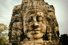 Enigmatic smiling giant stone face of Bayon temple, Angkor Thom Stock Photography