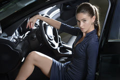 Enigmatic woman sitting inside the car Stock Photos