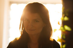 Enigmatic woman in sunset light Stock Photo