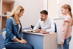 Enigmatical woman sitting in consulting room Royalty Free Stock Photography