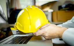 Enigneer is holding yellow safty work helmet Royalty Free Stock Photography