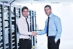 It enineers in network server room Royalty Free Stock Photography