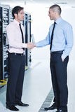 It enineers in network server room Stock Photography