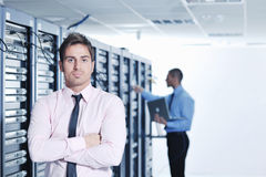 It enineers in network server room Royalty Free Stock Photo