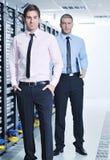 It enineers in network server room Royalty Free Stock Photos