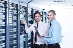 It enineers in network server room Stock Photo
