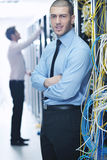 It enineers in network server room Royalty Free Stock Image