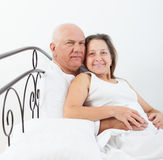 Enior  man and   woman  on   bed Royalty Free Stock Photo