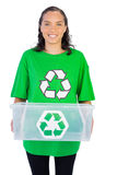 Enivromental activist holding box of recyclables Royalty Free Stock Photography