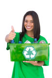 Enivromental activist holding box of recyclables and giving thum Royalty Free Stock Photo