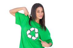 Enivromental activist pointing to the symbol on her tshirt and s Royalty Free Stock Images
