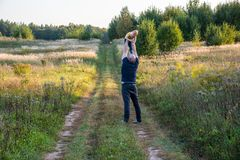 Enjoining moments of parenting. Father and son alone in nature playing royalty free stock photo