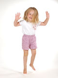Enjoy. Isolated jumping girl Royalty Free Stock Photos