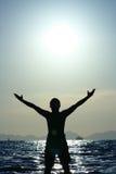 Enjoy. Men standing on beach in thailand Stock Photo