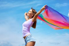Enjoy. Beautiful young Woman enjoy and jumping on the beach Royalty Free Stock Images
