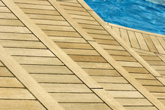 Enjoy. A wood terrace on the pool deck of a cruise ship stock photography