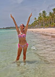 Enjoy the beach. Pretty woman with fit body enjoys the sun in the Caribbean beach Royalty Free Stock Photo