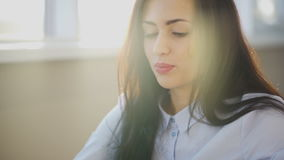 Enjoy beautiful face of young woman in rays of sun. stock footage
