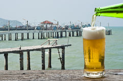 Enjoy beer at fisherman village pier. Stock Photos