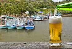 Enjoy beer with fisherman village port landscape. Royalty Free Stock Photos