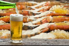 Enjoy beer with grilled giant shrimp. Royalty Free Stock Photo
