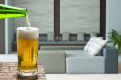 Enjoy beer in living room. Royalty Free Stock Photography