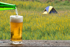 Enjoy beer in outdoor camp. Royalty Free Stock Photos