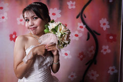 She is enjoy bride. A lovely and enjoy bride She is dressed in a simple gown and wearing a tiara Royalty Free Stock Images