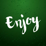 Enjoy calligraphic poster. Enjoy -hand drawn motivational, inspirational sign. Calligraphic poster. Modern brush calligraphy lettering isolated on chalk green Royalty Free Stock Photo