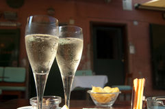 Enjoy champagne. In the sun at a cozy restaurant Royalty Free Stock Photography