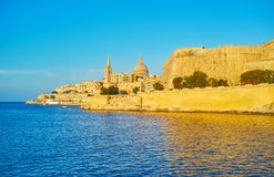 Fortified city of Valletta, Malta. Enjoy the city of Valletta from the Northern Harbour, St Paul`s Pro-Cathedral and Carmelite Church are seen amid the medieval stock photography