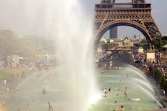 Summer Heat wave Paris. The Trocadero fountains by the Eiffel Tower. Enjoy the cold waters of fountain during a heat wave Heatwave alerts in the Paris  royalty free stock images