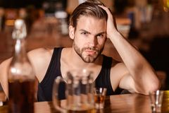 Enjoy the drinks, but not too much. Alcohol addiction and bad habit. Alcoholic man drinking at bar counter. Man drink. Strong alcoholic drink and beer in pub royalty free stock images