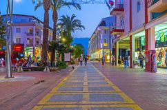 Enjoy evening Kemer, Turkey. KEMER, TURKEY - MAY 13, 2017: The evening walk in the city center, the stores of the central shopping street attract the tourists Stock Image