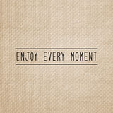 Enjoy every moment on brown tissue paper Royalty Free Stock Image