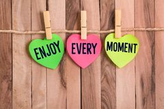 Enjoy every moment heart shaped note royalty free stock photography