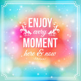 Enjoy every moment here and now. Motivating poster. Enjoy every moment here and now. Motivating bright yellow poster. Fantasy background with glitter particles Stock Photos