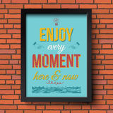 Enjoy every moment here and now. Stylized retro poster in a fram. E. Brick wall background. Vector illustration Stock Photos