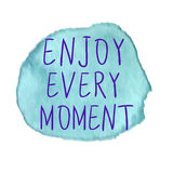 ENJOY EVERY MOMENT inscription on watercolor stain. VECTOR. Blue Stock Image