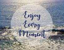 Enjoy every moment.Inspirational quote on beautiful ocean view background. Summer,vacation and travel concept.Selective focus stock image