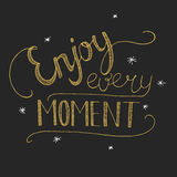 Enjoy every moment Lettering. On the black background Royalty Free Stock Image