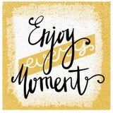 Enjoy every moment. Modern brush calligraphy. Handwritten ink lettering. Stock Photos