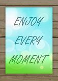 Enjoy every moment on the natural blurry background. Typography. On beautiful colorful background with bokeh Stock Photo